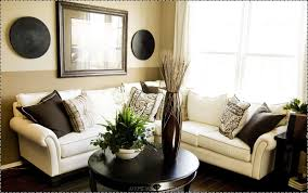 decor ideas for small living room grey fabric sofa and orange grey cushions connected by brown