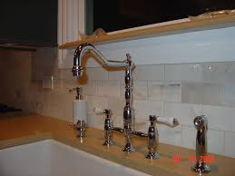 Bridge Kitchen Faucet With Side Spray by Delilah Deck Mount Bridge Faucet With Side Spray Cross Handles