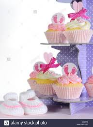 pink theme baby cupcakes and booties on purple polka dot