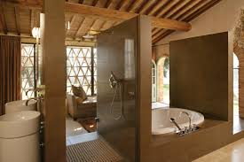 tuscan bathroom design with spa tub and chandelier inviting tuscan