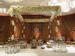 indian ceremony decor wedding flowers and decorations tall square lucite structure topped with a panel of floral combinations in white and ivory tones
