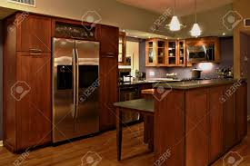 modern kitchen with handmade cabinets and stainless steel modern kitchen with handmade cabinets and stainless steel appliances stock photo 1583860