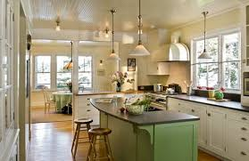top kitchen with white painted cabinets and green island my home