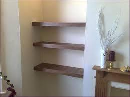 living room skinny floating shelves wall bookshelves coloured