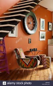 philippe xerri kilim chair under a cantilevered staircase the