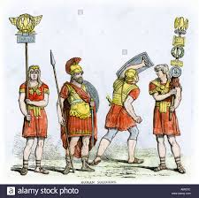 roman soldiers carrying insignia of the army of ancient rome stock