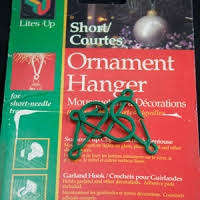green plastic ornament hangers