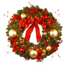 christmas accessories decorating a wreath decorating a wreath with ornaments decor
