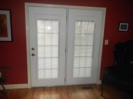 sliding french doors with blinds between the glass glass doors
