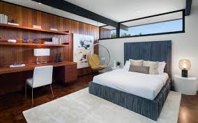 photo 9 of 18 in an award winning midcentury residence in los custom built ins provide an office space and storage in a guest bedroom a