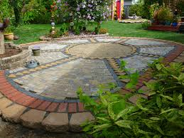 how to lay pavers for a patio wow thats a busy garden creating a paver and pebble mosaic patio