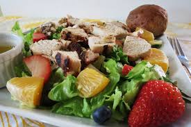 fruit salad with grilled chicken and citrus poppy seed dressing