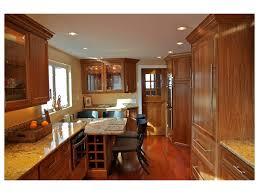 breakfast nook white cabinets wood trim stainless steel appliances