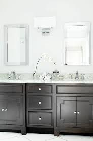 dark wood vanity in transitional white bathroom a dark wood vanity