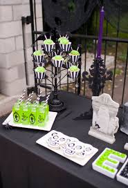 black and white halloween party planning a spooktacular halloween party in 5 easy steps hoopla