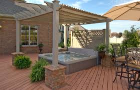 addign a pergola over your tub is a great way to add some