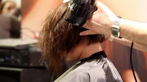 videos of girls barbershop haircuts for 2015 man barber washing male hair in a barbershop the client is smiling