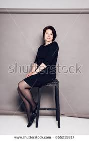 High Chair That Sits On Chair Free Woman Sitting In High Chair Photos Avopix Com