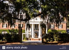 the colonial revival plantation house surrounded by live oak trees