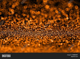 dark halloween background abstract spooky dark orange and black glitter sparkle fright night