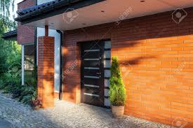 front door of a modern brick house stock photo picture and