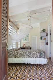 the greathouse longford hideaway the third bedroom features a full sized bed with ceiling fan and mosquito net