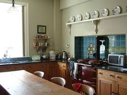 this original victorian kitchen with glass window and wooden table