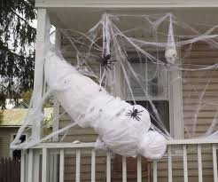 a life size spider victim decoration house and halloween ideas