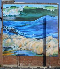 about murals amy bartlett wright mural showing three ocean waves painted on a brick wall
