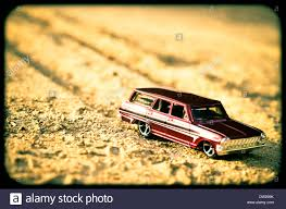 red toy jeep red toy car and sand stock photo royalty free image 67048735 alamy