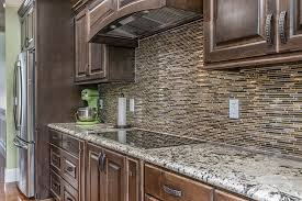 what backsplash goes with brown cabinets kitchen image galleries for inspiration