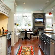 tv in kitchen ideas black kitchen nook with black waterfall counter kitchen isl and