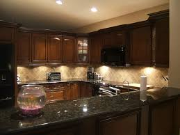 dark wood cabinets with light granite kitchen ideas high