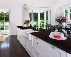 white kitchen cabinets and black quartz countertops the side black quartz and black granite countertops