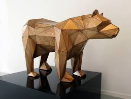 geometric wood sculpture geometric sculpture build from triangular shaped wooden pieces