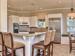 traditional kitchen with breakfast nook simple granite counters traditional kitchen with limestone tile window seat breakfast nook pendant light custom