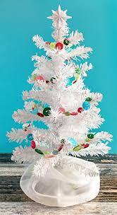 make a diy button garland for christmas carla schauer designs