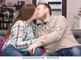 where to buy free hug sofa young couple kissing on sofa home stock photo royalty free