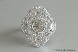 art deco 3 stone brilliant cut diamond ring new zealand