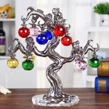 new apple tree made of financial tree ornaments silver bar