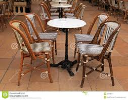 Small Round Tables by French Outdoor Cafe With Small Round Tables And Chairs Stock Photo