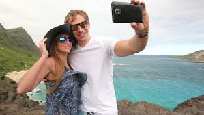 Hawaii best travel camera images Tourist woman taking selfie photo with smart phone best friends jpg