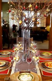 luxury christmas party centerpiece idea with gold christmas balls