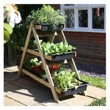 35 best garden planters images on pinterest herb garden planter