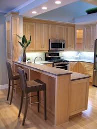 Titusville Cabinets Natural Maple Shaker Cabinets With Grey Silestone Quartz