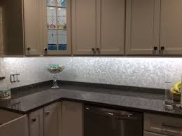 interior groutless mother of pearl shell tile kitchen backsplash