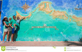 Map Of Caribbean Island by Family Of Four Near Big Map Of Caribbean Island Stock Illustration