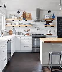 white kitchen cupboards black bench make a small kitchen look larger with these clever design