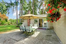Patio Set With Umbrella by Countryside House Exterior With Small Patio Area View Of Patio