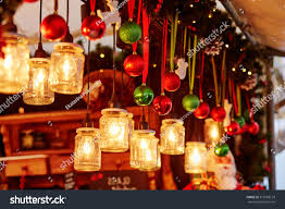 colorful christmas decorations and glass lanterns on a parisian